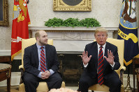 President Donald Trump, right, talks as Joshua Holt, who was recently released from a prison in Venezuela, joins him in the Oval Office of the White House, on May 26, 2018, in Washington. (AP Photo/Alex Brandon)