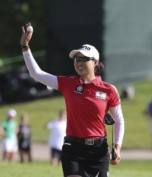 Minjee Lee, of Australia, waves after winning the LPGA Volvik Championship golf tournament on the final hole at the Travis Pointe Country Club, on May 27, 2018, in Ann Arbor, Mich. (AP Photo/Carlos Osorio)