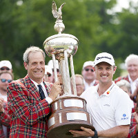 Justin Rose, of England, right, receives the trophy from Colonial Country Club President Rob Doby, left, after winning the Fort Worth Invitational golf tournament at Colonial Country Club in Fort Worth, Texas, on May 27, 2018. (AP Photo/Cooper Neill)