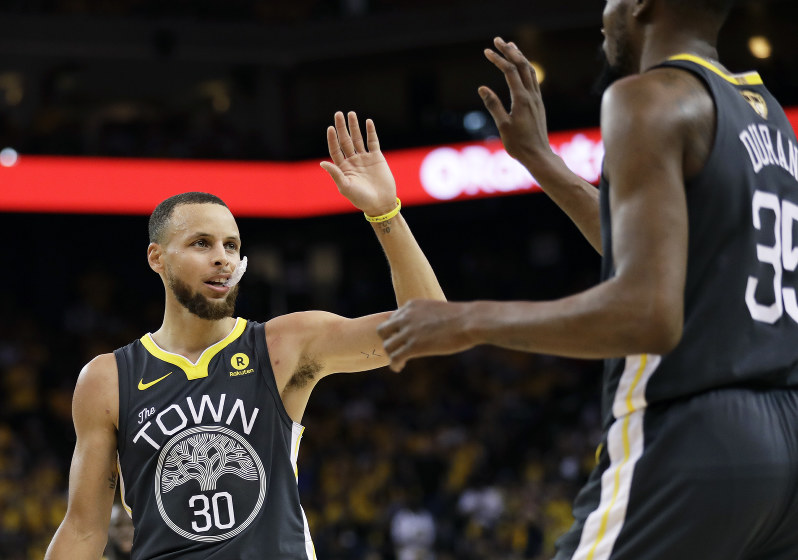 fa74fc0ea8c4 Golden State Warriors guard Stephen Curry (30) celebrates with forward  Kevin Durant during the first half of Game 2 of basketball s NBA Finals  against the ...