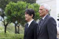 Japan's Prince Akishino, left, and Jim Horton, director of the National Cemetery of the Pacific, attend a wreath ceremony at the National Cemetery of the Pacific in Honolulu, on June 4, 2018. (AP Photo/Audrey McAvoy)