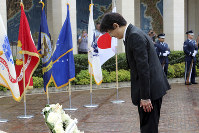 Japan's Prince Akishino attends a wreath ceremony at the National Cemetery of the Pacific in Honolulu, on June 4, 2018. (AP Photo/Audrey McAvoy)