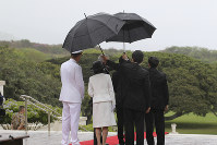 Japan's Prince Akishino, third right, back, listens to Jim Horton, Director of the National Cemetery of the Pacific, third left, both partly seen, as Adm. Phil Davidson, Commander of U.S. Pacific Command, left, and Princess Kiko, second left, stand by, during a wreath ceremony at the National Cemetery of the Pacific in Honolulu, on June 4, 2018. (AP Photo/Audrey McAvoy)