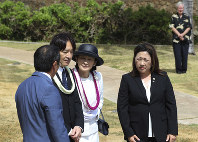 Japan's Prince Akishino, center left, and Princess Kiko, center right, listen at the Ehime Maru Memorial in Honolulu on June 4, 2018. (AP Photo/Audrey McAvoy)
