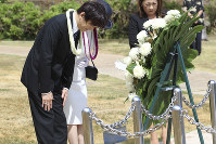 Japan's Prince Akishino, left, and Princess Kiko, center, bow before a wreath at the Ehime Maru Memorial in Honolulu on June 4, 2018. (AP Photo/Audrey McAvoy)