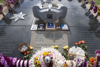 In this Feb. 9, 2011 file photo, flowers and lei are placed on the Ehime Maru Memorial at Kakaako Waterfront Park in Honolulu. (AP Photo/Eugene Tanner, File)