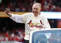 In this May 17, 2017 file photo, Red Schoendienst, manager of the St. Louis Cardinals' 1967 World Series championship team, takes part in a ceremony honoring the 50th anniversary of the victory, before a baseball game between the Cardinals and the Boston Red Sox in St. Louis. (AP Photo/Jeff Roberson)