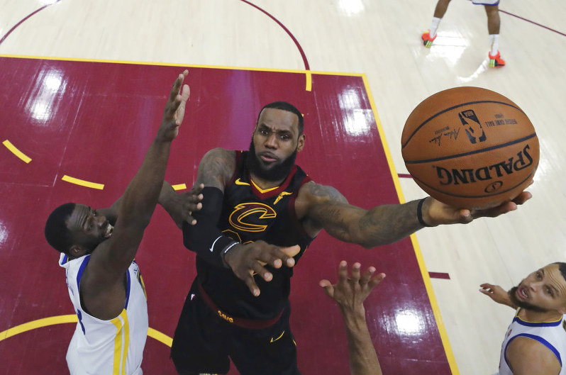 e2aab54b Cleveland Cavaliers' LeBron James shoots against Golden State Warriors'  Draymond Green during the first half of Game 3 of basketball's NBA Finals,  ...