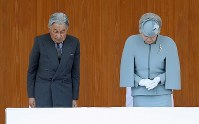 Emperor Akihito and Empress Michiko offer a silent prayer to victims of the Great East Japan Earthquake at the 69th national tree-planting festival in the city of Minamisoma, Fukushima Prefecture, on June 10, 2018. (Mainichi)