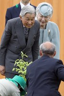 Emperor Akihito and Empress Michiko smile during the 69th national tree-planting festival in the city of Minamisoma, Fukushima Prefecture, on June 10, 2018. (Mainichi)