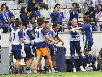 Japan's scorer Takashi Inui, right, celebrates with his teammates during a friendly soccer match between Japan and Paraguay at Tivoli Stadium in Innsbruck, Austria, on Tuesday, June 12, 2018. (AP Photo/Kerstin Joensson)