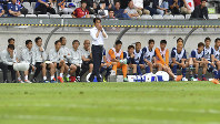 Japan's head coach Akira Nishino gestures during a friendly soccer match between Japan and Paraguay at Tivoli Stadium in Innsbruck, Austria, on Tuesday, June 12, 2018. (AP Photo/Kerstin Joensson)