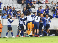 Japan's players celebrate after scoring during a friendly soccer match between Japan and Paraguay at Tivoli Stadium in Innsbruck, Austria, on Tuesday, June 12, 2018. (AP Photo/Kerstin Joensson)