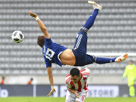Japan's Hiroki Sakai, above, and Paraguay's Angel Cardozo challenge for the ball during a friendly soccer match between Japan and Paraguay at Tivoli Stadium in Innsbruck, Austria, Tuesday, June 12, 2018. (AP Photo/Kerstin Joensson)