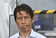 Japan's head coach Akira Nishino looks on prior to a friendly soccer match between Japan and Paraguay at Tivoli Stadium in Innsbruck, Austria, on Tuesday, June 12, 2018. (AP Photo/Kerstin Joensson)