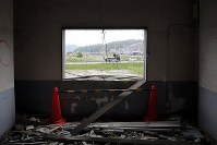 A new townscape under construction is seen from the former town hall that was struck by the tsunami that followed the March 2011 Great East Japan Earthquake, in Otsuchi, Iwate Prefecture, on June 13, 2018. (Mainichi)
