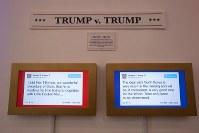 「トランプ大統領ツイッター図書館」で内容の矛盾するトランプ氏の投稿を掲示するコーナー。北朝鮮との交渉を巡り左は「時間の無駄」、右は「世界にとって良い」と書かれている=米カリフォルニア州ウエストハリウッドで2018年6月8日、ルーベン・モナストラ撮影