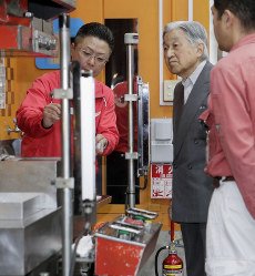 Emperor Akihito inspects a pressing machine at Hamano Products Co. Ltd. in Tokyo's Sumida Ward on June 15, 2018. (Pool photo)