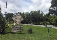 This June 4, 2018 photo shows a sign directing visitors to attractions on Avery Island in Louisiana, where Tabasco sauce is made. The product was first made in 1868 and celebrates its 150th year this year. (AP Photo/Beth J. Harpaz)