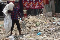 Hamidullah, 12, picks up plastic bottles in a dump site in New Delhi, on April 27 2018. (Khalil Hashmi)