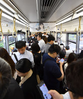 The inside of a JR train is seen after it made an emergency stop due to a powerful earthquake, in the town of Shimamoto, Osaka Prefecture, at 8:32 a.m. on June 18, 2018. (Mainichi)