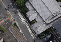 The scene where a man was killed by a collapsing wall is seen from a Mainichi Shimbun helicopter in Osaka's Higashiyodogawa Ward, on June 18, 2018. (Mainichi)