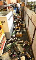 Broken bottles litter the floor of a restaurant in Ibaraki, Osaka Prefecture, after being knocked off their selves by a major quake in western Japan's Kansai region, on June 18, 2018. (Mainichi)