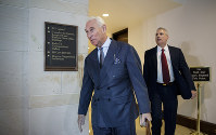 In this Sept. 26, 2017 file photo, longtime Donald Trump associate Roger Stone arrives to testify before the House Intelligence Committee, on Capitol Hill in Washington. (AP Photo/J. Scott Applewhite)