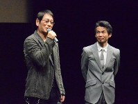 Actor Ren Osugi, left, relates a backstage anecdote about the film