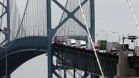In this on June 12, 2018, photo, trucks cross the Ambassador Bridge from Windsor, Ontario into Detroit. (AP Photo/Paul Sancya)