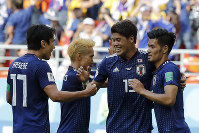 Japan's Makoto Hasebe, left, celebrates with Hiroki Sakai and Takashi Usami beating 2-1 Colombia during a group H match at the 2018 soccer World Cup in the Mordavia Arena in Saransk, Russia, on Tuesday, June 19, 2018. (AP Photo/Eugene Hoshiko)