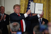 President Donald Trump shows off a
