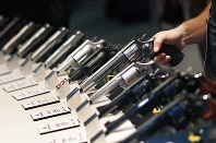 In this Jan. 19, 2016, file photo, handguns are displayed at a trade show in Las Vegas. (AP Photo/John Locher)