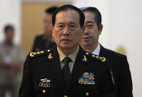 Chinese Defense Minister Wei Fenghe arrives at the Peace Palace for a meeting with Cambodian Prime Minister Hun Sen in Phnom Penh, Cambodia, on June 18, 2018. (AP Photo/Heng Sinith)