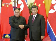 In this image taken from video footage run by China's CCTV on June 19, 2018, via AP Video, Chinese President Xi Jinping shakes hands with North Korean leader Kim Jong Un during a welcome ceremony at the Great Hall of the People in Beijing. (CCTV via AP Video)