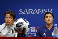 Japan's head coach Akira Nishino, left, and Japan's Makoto Hasebe, right, attend the official press conference at the 2018 soccer World Cup at the Mordovia Arena in Saransk, Russia, Monday, June 18, 2018. (AP Photo/Eugene Hoshiko)