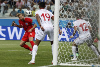 England's Harry Kane scores his side's 2nd goal against Tunisia during a group G match at the 2018 soccer World Cup in the Volgograd Arena in Volgograd, Russia, on June 18, 2018. (AP Photo/Alastair Grant)