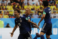 Japan's Yuya Osako celebrates scoring his side's second goal during the group H match against Colombia at the 2018 soccer World Cup in the Mordavia Arena in Saransk, Russia, on Tuesday, June 19, 2018. (AP Photo/Eugene Hoshiko)