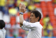 Japan's head coach Akira Nishino applauds at the end of the group H match between Colombia and Japan at the 2018 soccer World Cup in the Mordavia Arena in Saransk, Russia, on Tuesday, June 19, 2018. (AP Photo/Eugene Hoshiko)