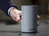 In this Sept. 27, 2017, file photo, a new Amazon Echo is displayed during a program announcing several new Amazon products by the company, in Seattle. (AP Photo/Elaine Thompson)