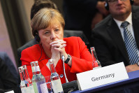 German Chancellor Angela Merkel attends a meeting in Berlin, on June 19, 2018, which prepares a climate change conference that takes place later this year in Poland's city Katowice. (AP Photo/Markus Schreiber, Pool)