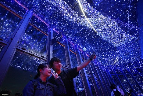 The observatory of Tokyo Tower is lit up during the