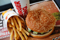 This Feb. 1, 2018, file photo shows a Burger King Whopper meal combo at a restaurant in the United States. (AP Photo/Gene J. Puskar)
