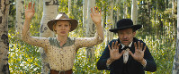 This image released by Magnolia Pictures shows Mia Wasikowska, left, and David Zellner in a scene from
