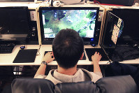 In this Dec. 11, 2013 file photo, a college student plays a computer game at an internet cafe in Seoul, South Korea. (AP Photo/Ahn Young-joon)
