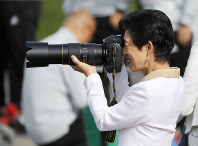 Japan's Princess Hisako takes photographs during a training session of the Japanese national team at the 2018 soccer World Cup in Kazan, Russia, on June 21, 2018. (AP Photo/Eugene Hoshiko)