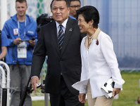 Japan's Princess Hisako is escorted by Japan Football Association President Kozo Tashima, left, to the training field, prior to a training session of the Japanese national team, at the 2018 soccer World Cup in Kazan, Russia, on June 21, 2018. (AP Photo/Eugene Hoshiko)