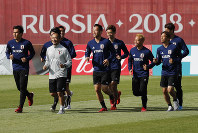 Japanese national team players warm up during a training session at the 2018 soccer World Cup in Kazan, Russia, on June 21, 2018. (AP Photo/Eugene Hoshiko)