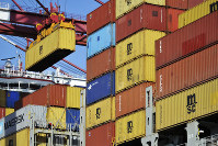 In this April 8, 2018 file photo, a container is loaded onto a cargo ship at a port in Qingdao in east China's Shandong province. (Chinatopix via AP)