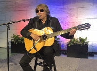 "Grammy Award-winning artist Jose Feliciano performs the ""Star-Spangled Banner"" at the Smithsonian' National Museum of American History in Washington, on June 14, 2018. (AP Photo/Luis Alonso Lugo)"